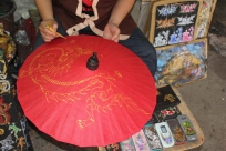 Last stage of the umbrella making is the painting which is done completely free hand