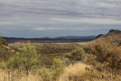 Seeing the MacDonnell Ranges from the Hat Hill Saddle with Simpsons Gap down to the right and Mount Sonder in the distance.